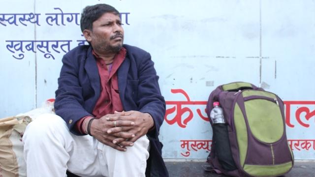 Dheeraj, 43, outside a <i>rain basera</i>.