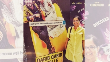 Tanuja Chandra strikes a pose against the poster of her upcoming film, <i>Qarib Qarib Singlle.</i>