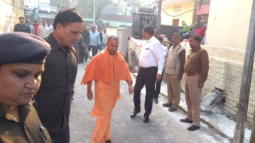 Uttar Pradesh Chief Minister Yogi Adityanath arrives at the polling station in Gorakhpur.