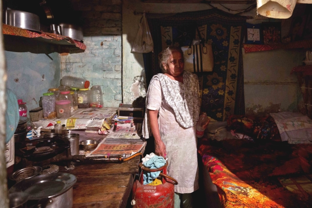 Veena Batra in her one-room house at Majnu ka Tila. Currently, Veena doesn't have a metre, but has sublet a connection from her son; her own metre was removed due to non-payment of dues.