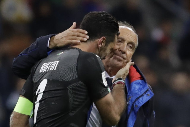 Italy goalkeeper Gianluigi Buffon is comforted by Italy coach Gian Piero Ventura.