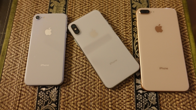 iPhone X (centre) along with iPhone 8 (left) and iPhone 8 Plus (right)