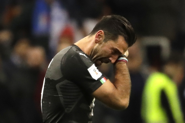 Italy goalkeeper Gianluigi Buffon cries after his team got eliminated in the World Cup qualifying play-off second leg soccer match between Italy and Sweden, at the Milan San Siro stadium, Italy, Monday, Nov. 13, 2017.