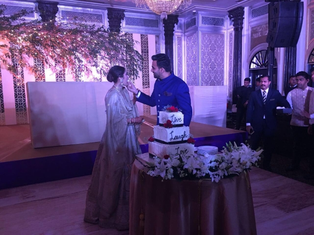 Zaheer and Sagarika feed each other the reception cake.