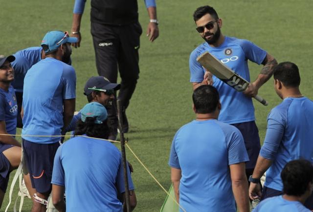 Virat Kohli speaks to his team during a training session in Kolkata.