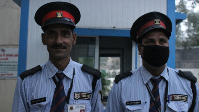 Ram Veer Singh (left) along with another guard at the gates of Ambedkar University.