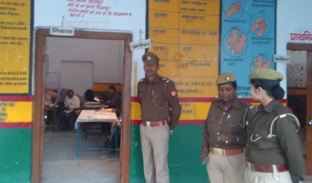 Police officials at the polling station in Gorakhpur.