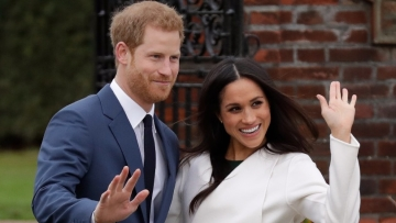 Britain's Prince Harry and his fiancee Meghan Markle pose for photographers during a photocall in the grounds of Kensington Palace in London, on Monday, 27 November.