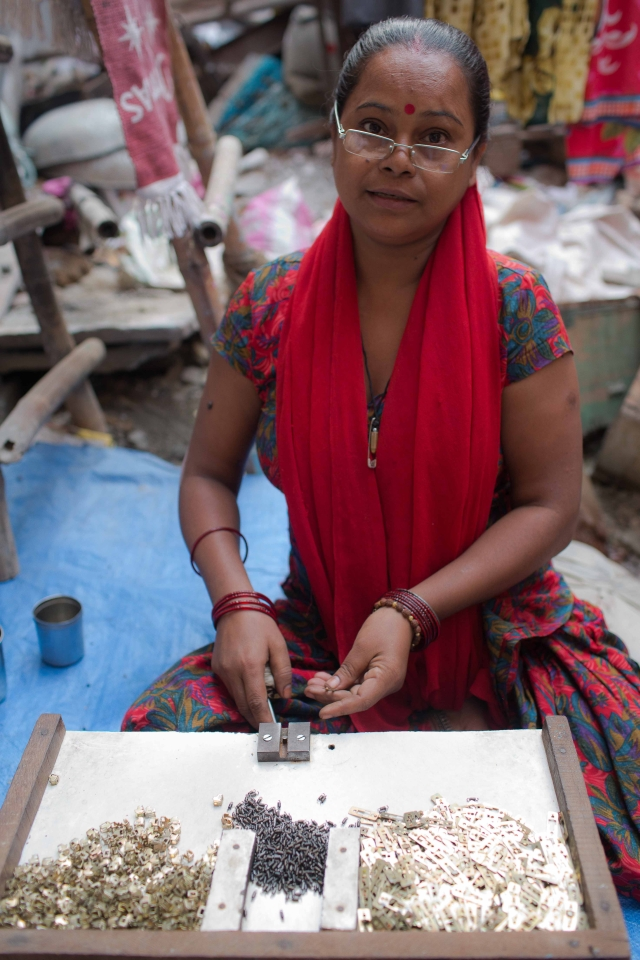 Shristi works from her home to place springs into switches. For every 144 springs fitted into the switches, she earns Rs 3. On an average, she earns about Rs 50 per day.
