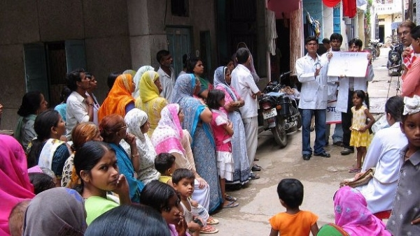 Students from the All India Institute of Medical Sciences conduct a community education programme in a Delhi slum.