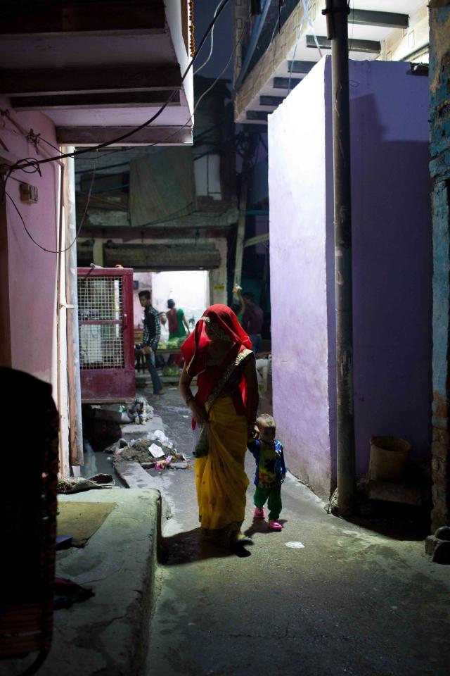 A woman with her kid in the narrow lanes of Kabir Nagar basti, north Delhi.