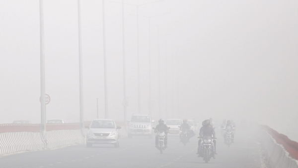 Motorists drive surrounded by smog in New Delhi on 8 November 2017.
