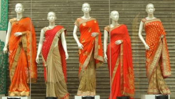 Mannequins wearing sarees.