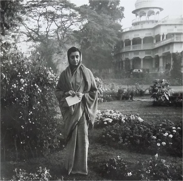 1959: Indira Gandhi standing in the lawns of Anand Bhavan in Allahabad. A symbolic photograph where her childhood home stands in the background with her ancestral legacy, and she  stands as the Prime Minister with a vision to lead the country forward.