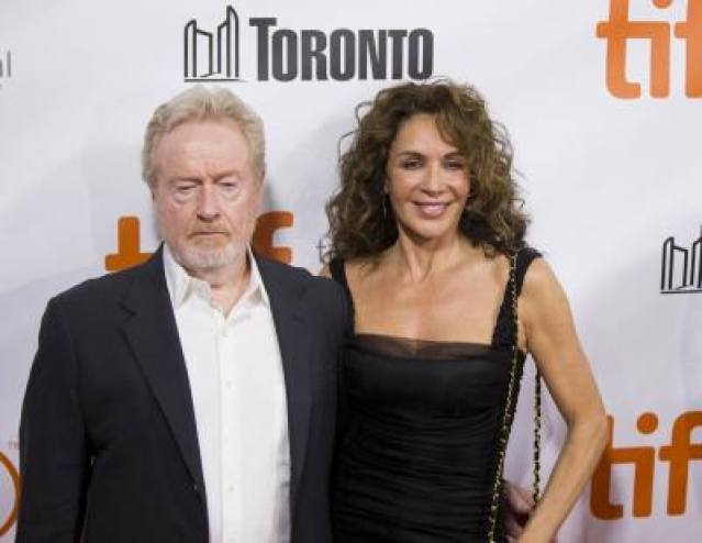 """TORONTO, Sept. 12, 2015 (Xinhua) -- Director Ridley Scott (L) and his wife pose for photos before the world premiere of the film """"The Martian"""" at Roy Thomson Hall during the 40th Toronto International Film Festival in Toronto, Canada, Sept. 11, 2015. The 40th Toronto International Film Festival (TIFF) runs from Sept. 10-20, 2015. (Xinhua/Zou Zheng/IANS) (zjy)"""