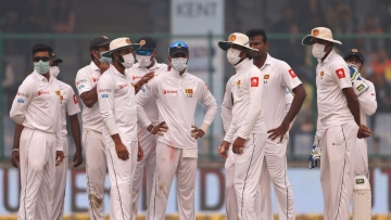 Sri Lankan cricketers were forced to wear masks while fielding.<i></i>