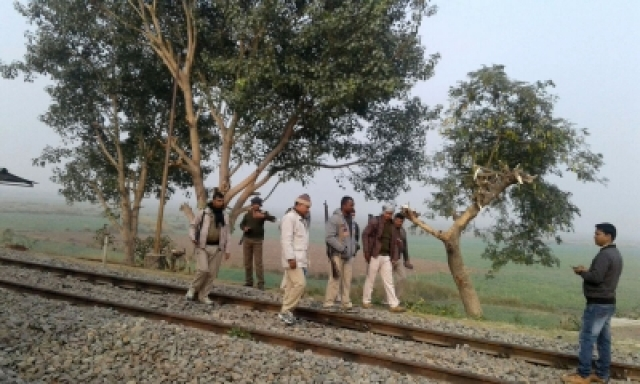 Patna: Policemen Masudan railway station that was attacked by Maoists in Bihar on Dec 20, 2017. Maoists killed a deputy village body head, torched cabin panel and abducted two railway employees -- station master Mukesh Kumar and porter Narendra Mandal -- to enforce a shutdown they had called on Wednesday. (Photo: IANS)