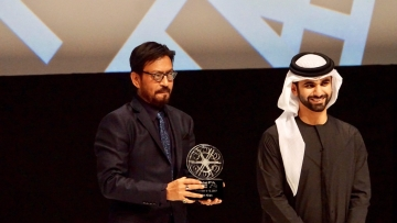 Irrfan Khan accepting the Honorary Award at the opening night gala of the Dubai International Film Festival (DIFF).