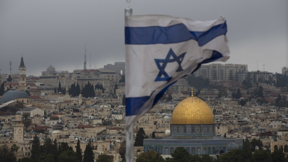 US President Donald Trump holds up a proclamation to officially recognize Jerusalem as the capital of Israel.