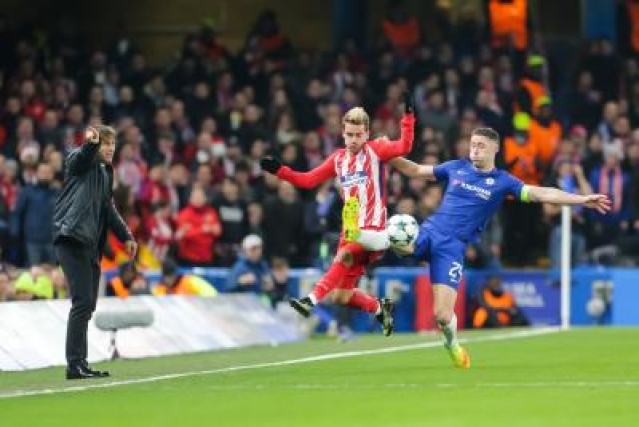 LONDON, Dec. 6, 2017 (Xinhua) -- Antoine Griezmann of Atletico Madrid battles with Gary Cahill(R) of Chelsea during the UEFA Champions League Group C match between Chelsea and Atletico Madrid at Stamford Bridge in London, Britain on Dec. 5, 2017. The match drew 1-1. (Xinhua/Richard Washbrooke/IANS)