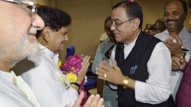 Mohan Rathwa with Ahmed Patel.