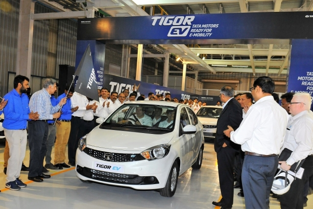 Guenter Butschek, CEO & MD, Tata Motors, drives off the first Tigor EV sedan post the ceremonial flag off at the Sanand plant.