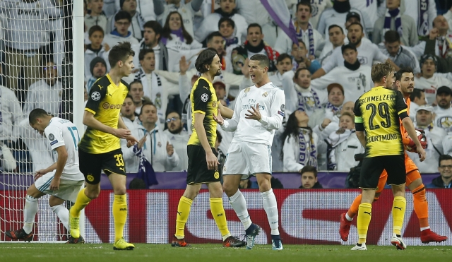 Madrid's Cristiano Ronaldo, center, reacts during the Champions League Group H soccer match.