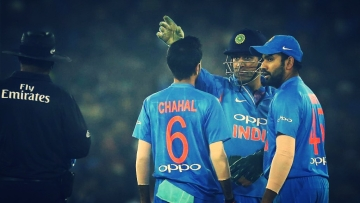 MS Dhoni with Yuzvendra Chahal of India and Rohit Sharma Captain of India during the first International T20 match (T20i) held at the the Barabati Stadium, Cuttack between India and Sri Lanka on the 20th December 2017