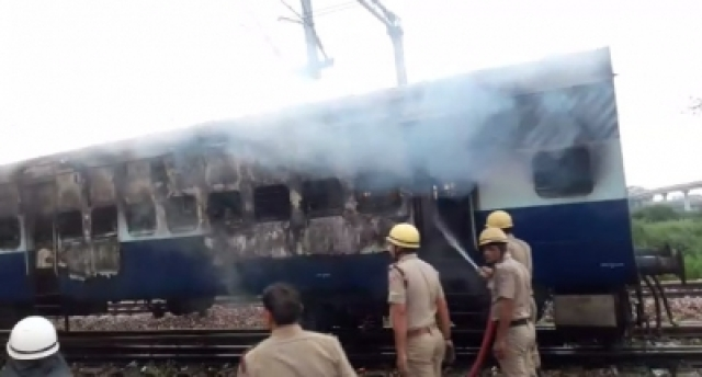 Delhi: Firefighters douse fire after two bogies of a train standing in a yard of Anand Vihar Railway Station in east Delhi caught fire on Aug 25, 2017. (Photo: IANS)