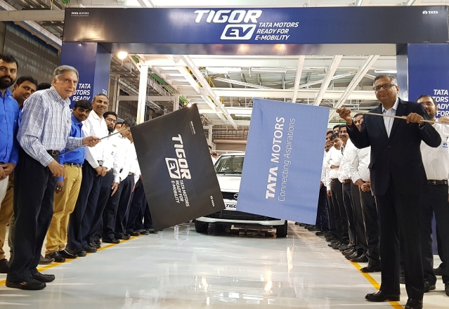 Ratan N Tata, Chairman Emeritus, Tata Group and N Chandrasekaran, Chairman, Tata Sons and Tata Motors flagging off the first batch of Tigor EVs from the Sanand plant.