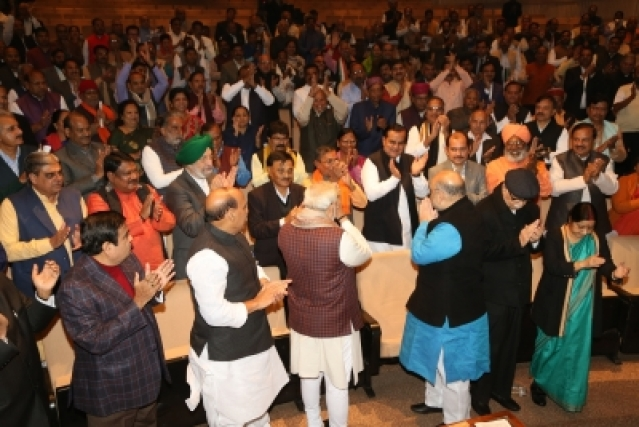 New Delhi: BJP president Amit Shah, Prime Minister Narendra Modi greets other leaders during the BJP Parliamentary Party meeting at Parliament House in New Delhi on Dec. 20, 2017.  (Photo: Amlan Paliwal/IANS)