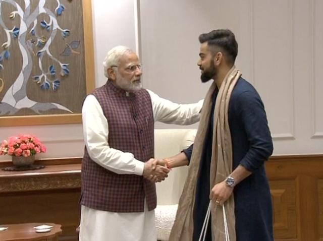 Modi greets Kohli.