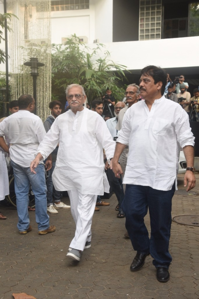 Gulzar arrives for the service.