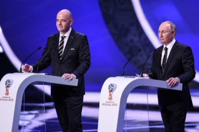 MOSCOW, Dec. 2, 2017 (Xinhua) -- FIFA President Gianni Infantino (L) and Russian President Vladimir Putin attend the Final Draw of the FIFA World Cup 2018 at the State Kremlin Palace in Moscow, capital of Russia, Dec. 1, 2017. (Xinhua/Evgeny Sinitsn/IANS)