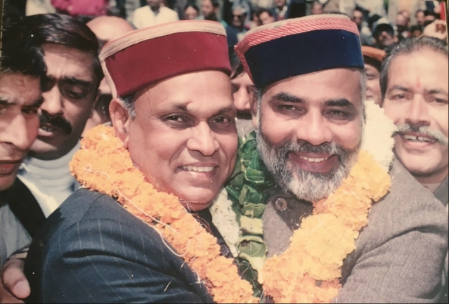 An old photo of BJP CM candidate Prem Kumar Dhumal with Prime Minister Narendra Modi.