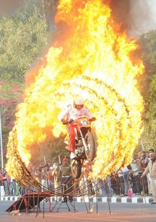 Daredevil Motorcyclist performs stunts for the audience at the Military Literature Festival.