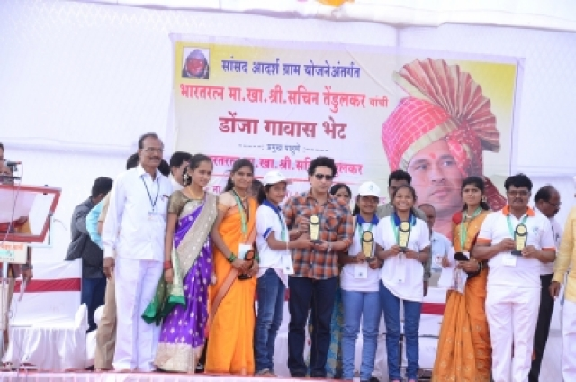 Osmanabad: Cricket legend Sachin Tendulkar felicitates children in Donja village in Osmanabad district of Maharashtra on Dec 19, 2017. The Rajya Sabha MP had come on his maiden trip to review the status of several project works in the village which he has