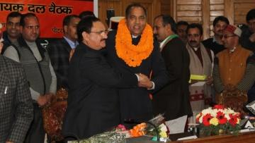 Jairam Thakur being congratulated by JP Nadda.