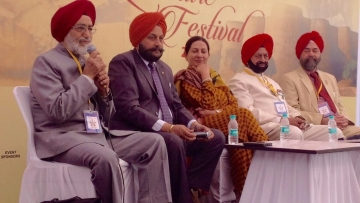 Brig OS Goraya throwing light on the 'Military Writing in Punjabi' during panel discussion at the Military Literature Festival.