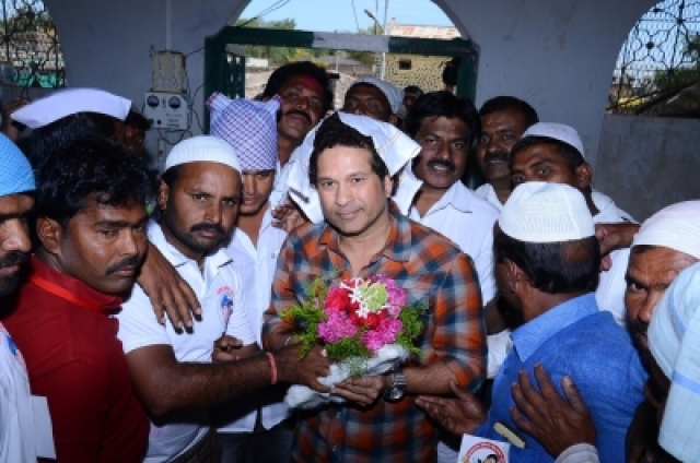 Osmanabad: Cricket legend Sachin Tendulkar being welcomed by villagers in Donja village in Osmanabad district of Maharashtra on Dec 19, 2017. The Rajya Sabha MP had come on his maiden trip to review the status of several project works in the village which he has