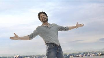 SRK in his signature pose.