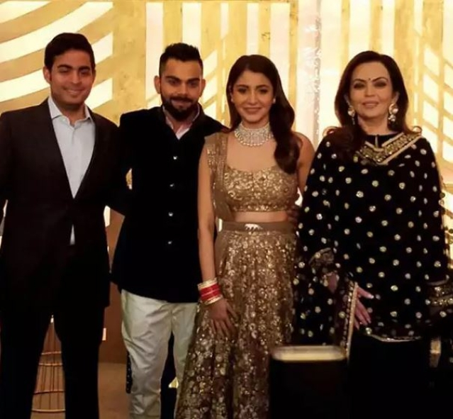 The couple with the Ambanis.