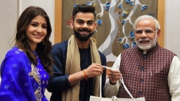Virat kohli and Anushka Sharma with Narendra Modi.
