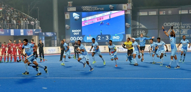 Indian team players celebrate after Akash Chikte stops the a Belgian penalty shot to win the quarter-final.
