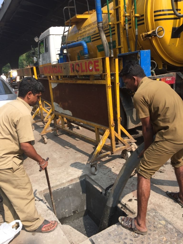 BMC storm drain cleaners work on a choked drain near Mazgaon.