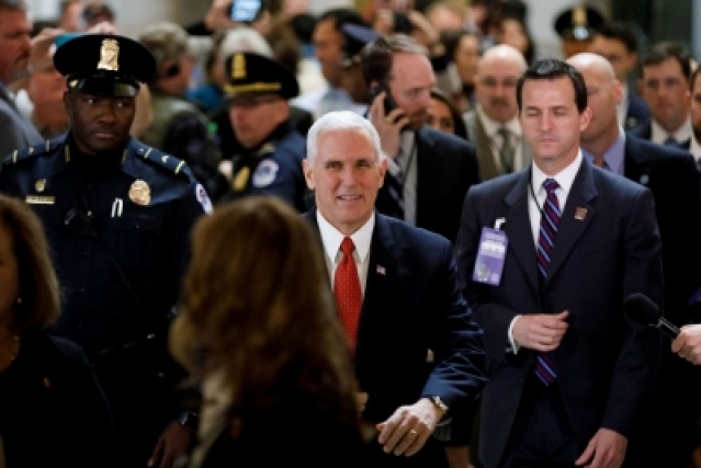 WASHINGTON, Dec. 19, 2017 (Xinhua) -- U.S. Vice President Mike Pence (C) is seen before a vote on the tax bill at the Capitol Hill in Washington D.C., the United States, on Dec. 19, 2017. The U.S. House of Representatives will have to vote again on the Republican tax bill on Wednesday as some provisions in the bill didn