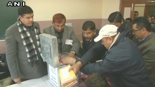 Postal ballots de-sealed by officials at a counting centre in Shimla's Sanjauli, as counting of votes begins.