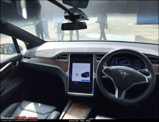 The Tesla Model X dashboard is dominated by a large central screen.