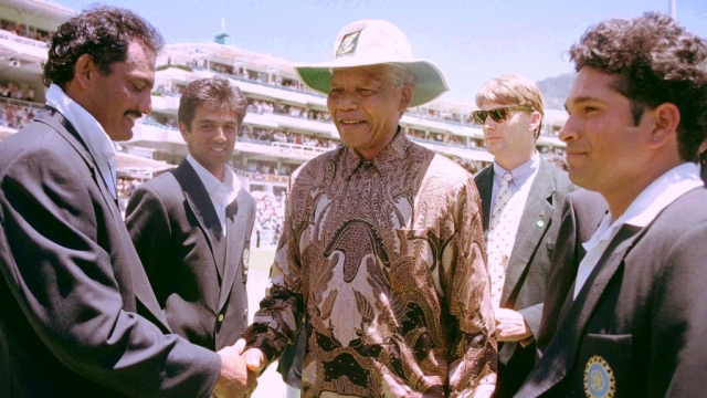 The then South African President Nelson Mandela (C) is introduced to Mohammad Azharuddin (L) by the then Indian captain Sachin Tendulkar (R) in 1997.