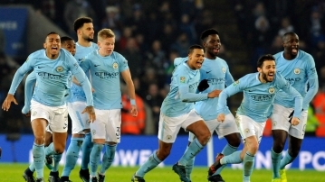 Manchester City players celebrate after beating Leicester City on penalties during the League Cup Quarter Final.